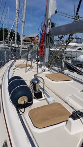 Island Packet 420 Hatch covers Sunbrella toast with navy accents